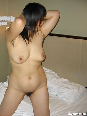 My Cute Asian : Asian shows the brush on the level breast increased by bedraggled pussy